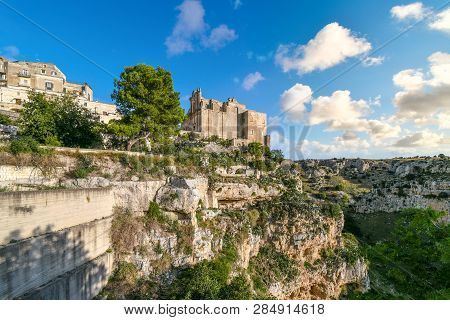 The Medieval City Of Matera, Italy, With The Convent Of Saint Agostino Sitting On A Steep Cliff Over
