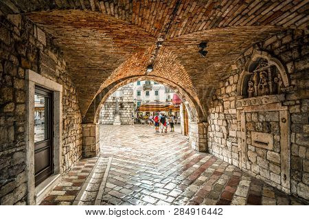 Otor, Montenegro - September 14 2018: The Square Of The Arms Opens Out  In Front As Tourists Enter T