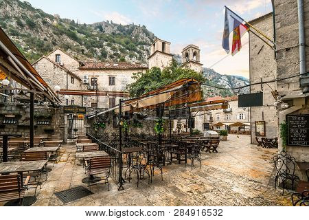 Kotor, Montenegro - September 17 2018: An Outdoor Sidewalk Cafe Sits Empty Early In The Morning Near
