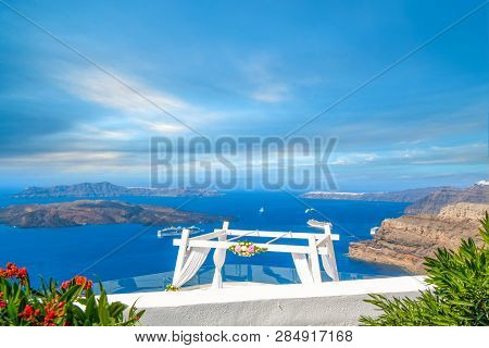 View Of The Aegean Sea, Cruise Ships, And The Santorini Caldera From A Mountaintop Wedding Venue In