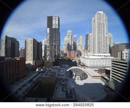 aerial elevated view up above the Chicago River North district looking north from between highrise skyscraper office buildings, ultra wide angle, fish eye poster