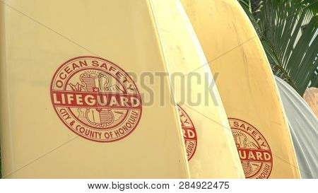 Honolulu, United States Of America - August 5 2015: A Number Of Lifeguard Rescue Surfboards At Waiki