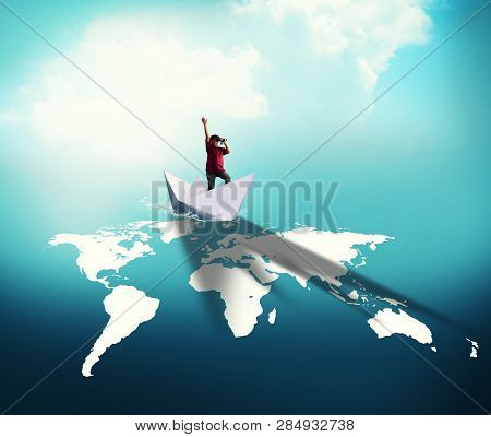 Traveller Navigate With Paper Boat Over World Map.
