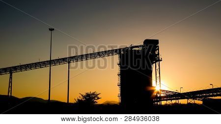 Silhouette Of A Mining Silo And Conveyor Belts