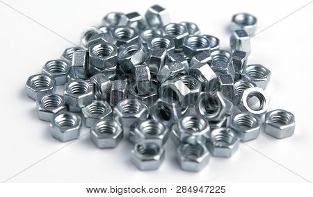 Stack Of Shiny Nuts On A White Background