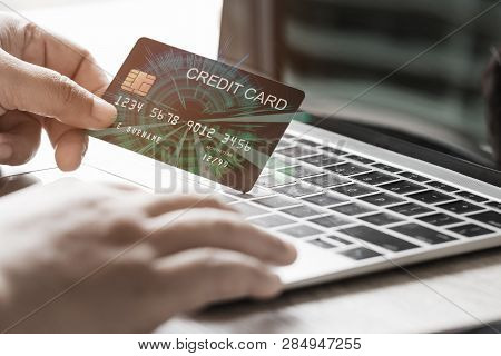 Using Laptop Keyboard By Hand To Sent The Credit Card Number For Trading. Consumer Can Buy Products