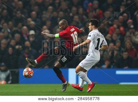 MANCHESTER, ENGLAND - FEBRUARY 12 2019: Ashley Young of Manchester United and Juan Bernat of PSG during the Champions League match between Manchester United and Paris Saint-Germain