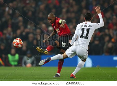 MANCHESTER, ENGLAND - FEBRUARY 12 2019: Ashley Young of Manchester United and Angel Di Maria of PSG during the Champions League match between Manchester United and Paris Saint-Germain at Old Trafford