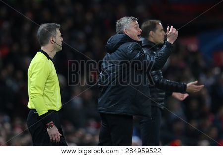 MANCHESTER, ENGLAND - FEBRUARY 12 2019: Ole Gunnar Solskjaer Manager of Manchester United and Thomas Tuchel Manager of PSG during the Champions League match