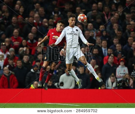 MANCHESTER, ENGLAND - FEBRUARY 12 2019: Alexis Sanchez of Manchester United  and Thilo Kehrer of PSG during the Champions League match between Manchester United and Paris Saint-Germain