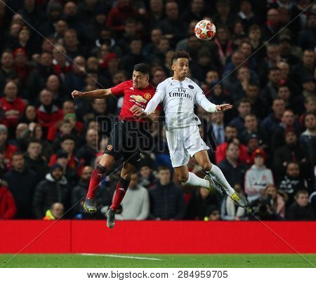 MANCHESTER, ENGLAND - FEBRUARY 12 2019: Alexis Sanchez of Manchester United and Thilo Kehrer of PSG during the Champions League match between Manchester United and Paris Saint-Germain at Old Trafford