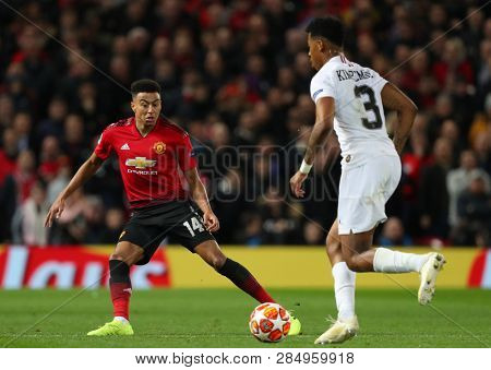 MANCHESTER, ENGLAND - FEBRUARY 12 2019: Jesse Lingard of Manchester United and Presnel Kimpembe of PSG during the Champions League match between Manchester United and Paris Saint-Germain