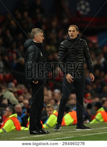 MANCHESTER, ENGLAND - FEBRUARY 12 2019: Ole Gunnar Solskjaer Manager of Manchester United and Thomas Tuchel Manager of PSG during the Champions League match between Manchester United and PSG.