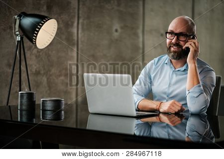 Middle-aged designer working in an office