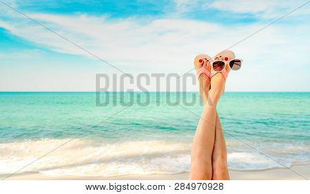 Upside Woman Feet And Red Pedicure Wear Pink Sandals, Sunglasses At Seaside. Funny And Happy Fashion