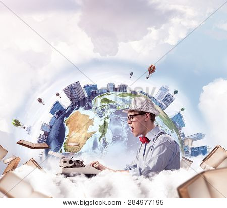 Emotional Young Man Writer In Hat And Eyeglasses Feeling Surprised While Using Typing Machine At The