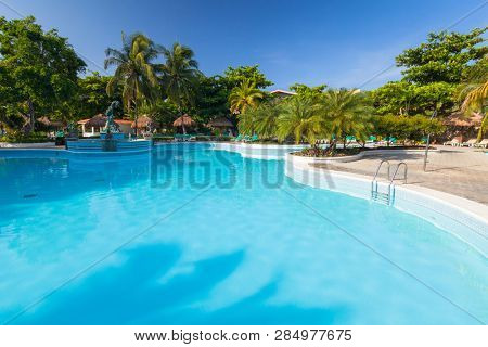 Playa Del Carmen, Mexico - July 17, 2011: Scenery of luxury swimming pool at RIU Playacar Hotel in Playa del Carmen, Mexico. RIU Hotels & Resorts has more than 100 hotels in 19 countries