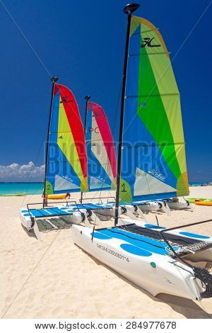 Playa Del Carmen, Mexico - July 20, 2011: Colorful sail catamarans on the beach of Playacar at Caribbean Sea of Mexico. This resort area is popular destination with the most beautiful beaches