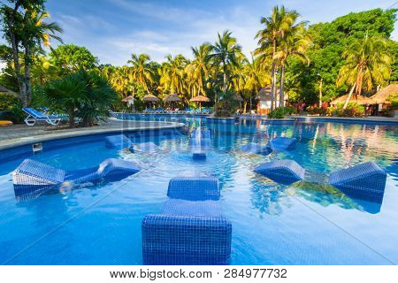 Playa Del Carmen, Mexico - July 21, 2011: Scenery of luxury swimming pool at RIU Tequila Hotel in Playa del Carmen, Mexico. RIU Hotels & Resorts has more than 100 hotels in 19 countries