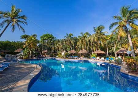 Playa Del Carmen, Mexico - July 17, 2011: Scenery of luxury swimming pool at RIU Tequila Hotel in Playa del Carmen, Mexico. RIU Hotels & Resorts has more than 100 hotels in 19 countries