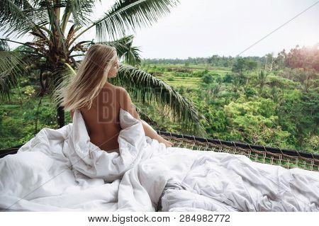 Healthy Sleep In The Open Air. Sexy Woman Relaxing At Villa, Beautiful View