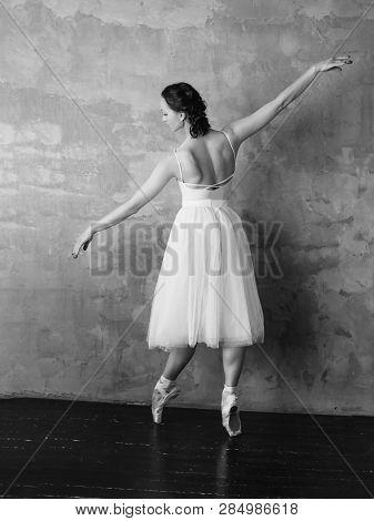 Ballet Dancer Ballerina In Beautiful Light White Dress Tutu Skirt Posing In Loft Studio