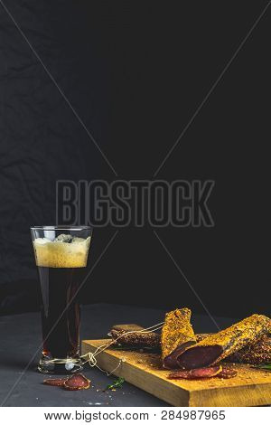 Dark Beer In Glass And Jerky, Basturma, Dried Meat Beef