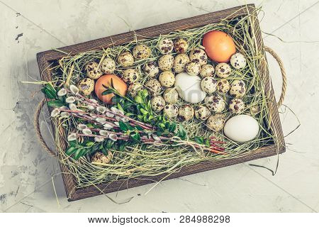 Quail And Chicken Eggs On The Hay In Wooden Box