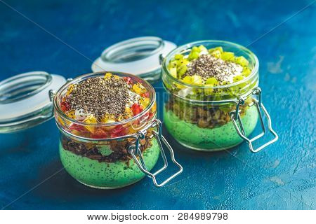 Two Chia Seed Pudding With Matcha Green Tea In Glasses