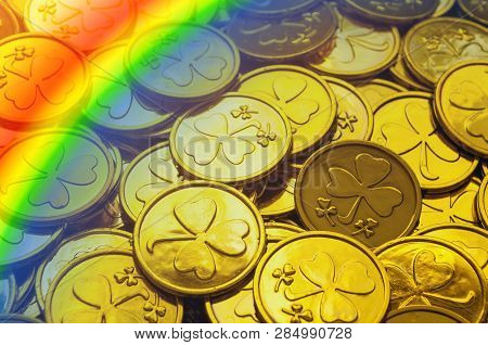 St Patrick's Day background. Golden coins with shamrock and rainbow, St Patrick's day symbols. St Patricks day festive concept