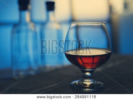 Glass Cognac Bar Studio Background Blue Color