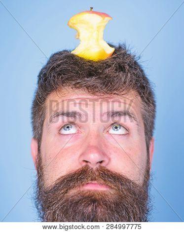 Man Handsome Hipster Long Beard Almost Eaten Apple Stump On Head As Target. Live Target Concept. Wei