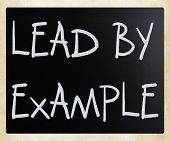 """Lead by example"" handwritten with white chalk on a blackboard poster"