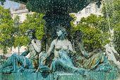 Fountain in the Rossio Square in Lisbon, Portugal poster