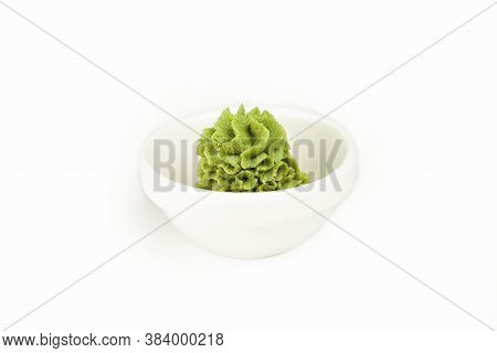 Bowl With Wasabi Sauce On A White Plate. For The Restaurant Menu. Traditional Chinese Classic Wasabi