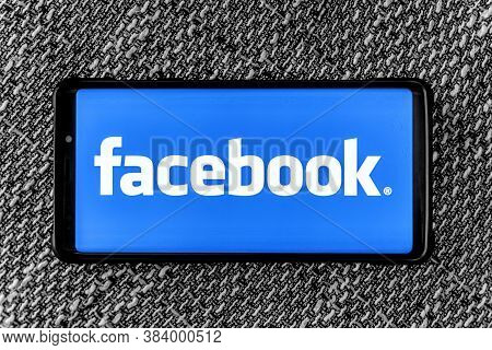 Uzhgorod, Ukraine - September 6, 2020: Facebook Page On The Smartphone On Fabric Background. Faceboo