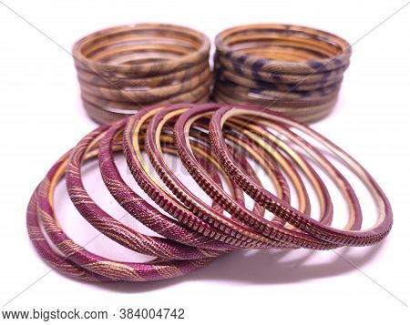 Sets Of Multicolored Bangles Isolated On White Background. Bangles Are Traditionally Rigid Bracelets