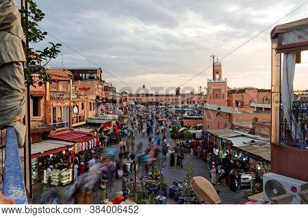 Marrakesh, Morocco, .okt, 7, 2018:djemaa El Fna Market Square, People Tourists Stroll Across The Squ