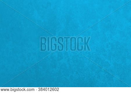 Blue Grunge Background. Bright Blue Wall Surface. Saturated Background.