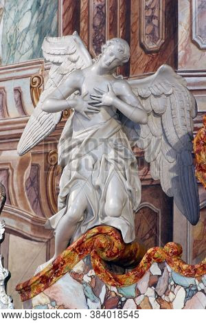 ZAGREB, CROATIA - MAY 16, 2013: Angel statue on the altar at St. Catherine of Alexandria Church in Zagreb, Croatia
