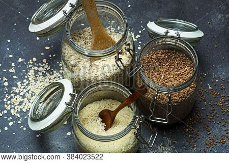 Cereals (oatmeal, Buckwheat, Rice) In Glass Jars In The Kitchen. Gluten Free Concept. Varieties Of C
