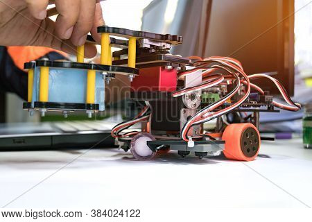 Robotics Technology, Stem Education Lab Learning Coding Study Concept : Metal Robot And Electronic B