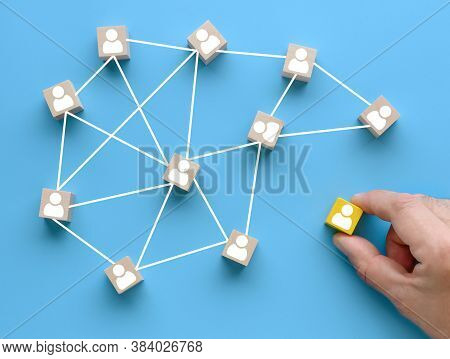 Building A Team. Joining A Team. Wooden Cubes With People Icon On Blue Background. Social Network, L