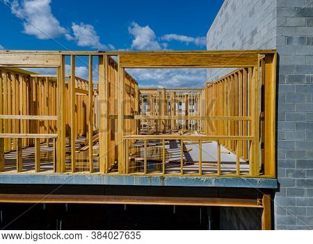 Framing Of Under Construction Wooden House Building Frame Structure On A New Development
