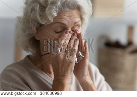 Close Up Exhausted Mature Woman Suffering From Eye Strain
