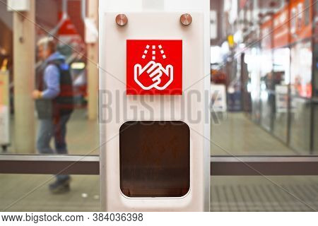 Heidelberg, Germany - March 2020: Red Hand Washing Sign At Public Hand Disinfector In Shopping Mall