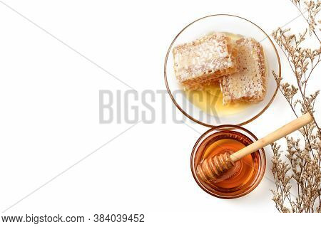 Honeycomb On Dish With Honey Dipper And Dry Flower Isolated On White Background And Copy Space, Bee