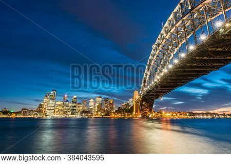 Colorful Sydney Downtown Skyline With Harbor Bridge At Night In Sydney, New South Wales, Australia.
