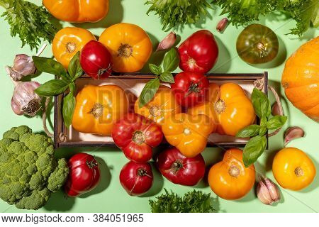 Top View Harvest Of Fresh Farm Vegetables In Small Box And On Pastel Green Background. View Above. F