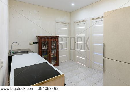 Kitchen Interior With Temporary Poor Furniture In A New Building